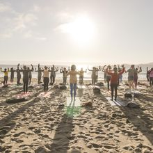 Sunday Ritual silent disco beach yoga with Sarah Allison